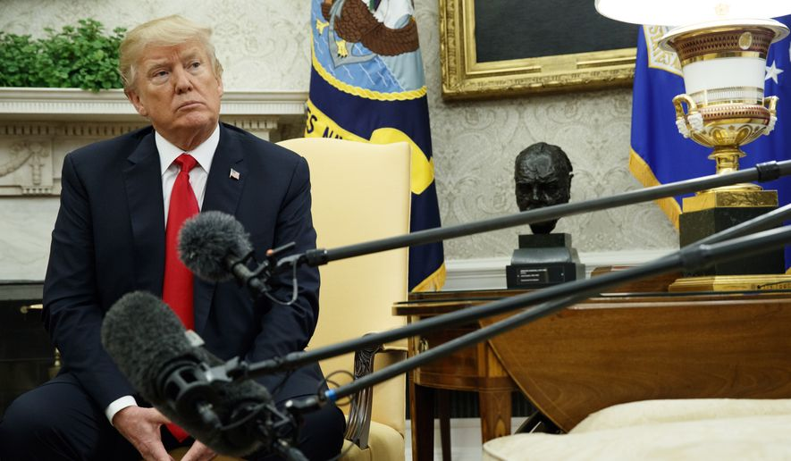 President Donald Trump listens to a question during a meeting with Swedish Prime Minister Stefan Lofven in the Oval Office of the White House, Tuesday, March 6, 2018, in Washington. (AP Photo/Evan Vucci)