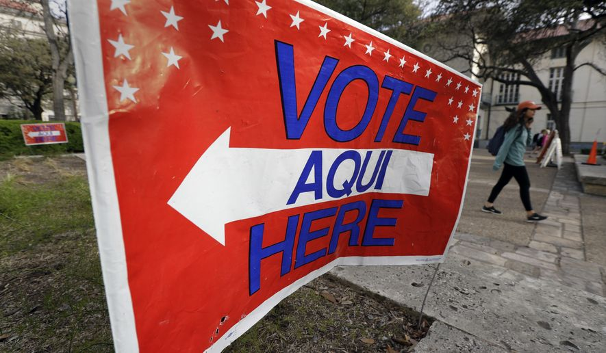 A sign directs voters to a Texas primary election polling site on the University of Texas campus, Tuesday, March 6, 2018, in Austin, Texas. (AP Photo/Eric Gay)