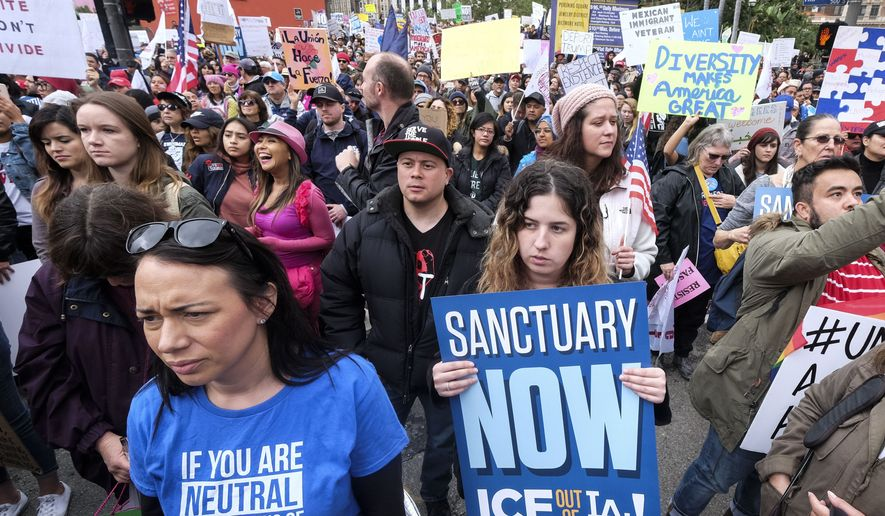 Thousands of people take part in the ``Free the People Immigration March,'' to protest actions taken by President Donald Trump and his administration, in Los Angeles Sunday, Feb. 18, 2017. March and rally organizers are calling for an end to ICE raids and deportations, minority killings by police and that health care be provided for documented and undocumented individuals. Immigrant, faith, labor and community groups are expected to attend, calling for sanctuary to be given to immigrants.. (AP Photo/Ringo H.W. Chiu)