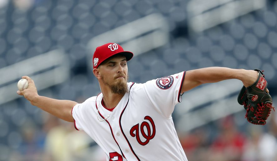 Washington Nationals starting pitcher A.J. Cole (22) works against the Houston Astros during a spring training baseball game Tuesday, March 6, 2018, in West Palm Beach, Fla. (AP Photo/John Bazemore) **FILE**