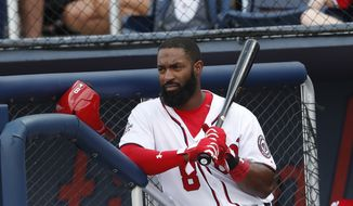 Washington Nationals center fielder Brian Goodwin (8) waits to hit against the Houston Astros in a spring training baseball game Tuesday, March 6, 2018, in West Palm Beach, Fla. (AP Photo/John Bazemore) **FILE**
