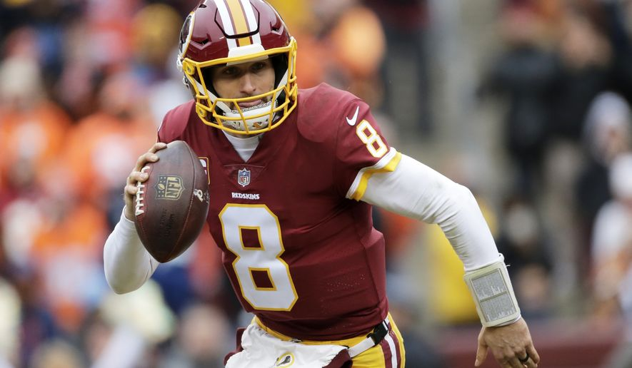 FILE - In this Dec. 24, 2017, file photo, Washington Redskins quarterback Kirk Cousins scrambles during an NFL football game against the Denver Broncos in Landover, Md. After agreeing to a trade to acquire quarterback Alex Smith, the Redskins are moving on from the Kirk Cousins era. When the league year opens in mid-March, Cousins will be the top free agent available and find no shortage of suitors for his services. (AP Photo/Mark Tenally, File)