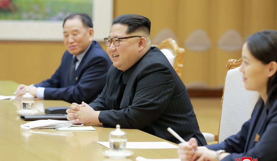 """In this Monday, March 5, 2018 photo, provided by the North Korean government on March 6, North Korean leader Kim Jong Un, center, his sister Kim Yo Jong, and Vice Chairman of North Korea's ruling Workers' Party Central Committee Kim Yong Chol meet members of South Korean delegation headed by National Security Director Chung Eui-yong in Pyongyang, North Korea. Independent journalists were not given access to cover the event depicted in this image distributed by the North Korean government. The content of this image is as provided and cannot be independently verified. Korean language watermark on image as provided by source reads: """"KCNA"""" which is the abbreviation for Korean Central News Agency. (Korean Central News Agency/Korea News Service via AP)"""