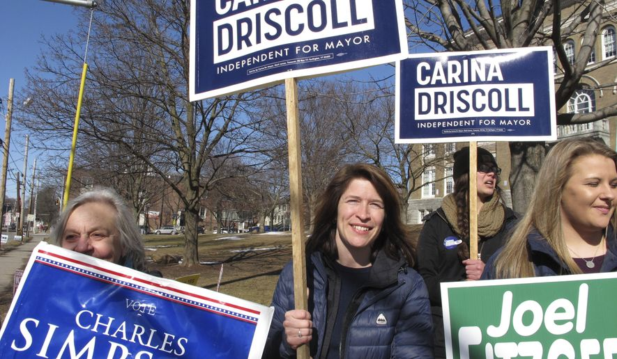 Carina Driscoll, center, Bernie Sanders' stepdaughter, campaigns outside a polling place in Burlington, Vt. on Tuesday, March 6, 2018. She's running for mayor of Burlington, Vt., where the independent senator got his political start. (AP Photo/Lisa Rathke)