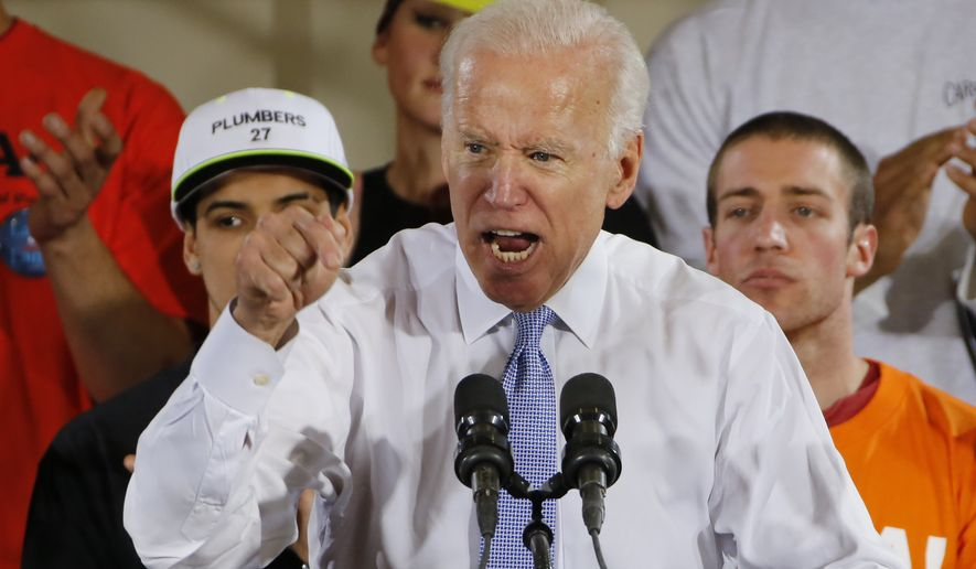 Former Vice President Joe Biden speaks at a rally in support of Conor Lamb, the Democratic candidate for the March 13 special election in Pennsylvania's 18th Congressional District, at the Carpenter's Training Center in Collier, Pa., Tuesday, March 6, 2018. (AP Photo/Gene J. Puskar)