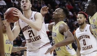 Boston College's Nik Popovic (21) looks to shoot as Georgia Tech's Josh Okogie (5) defends during the second half of an NCAA college basketball game in the first round of the Atlantic Coast Conference tournament Tuesday, March 6, 2018, in New York. Boston College won 87-77. (AP Photo/Frank Franklin II)