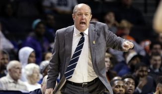 Pittsburgh head coach Kevin Stallings calls out to his team during the first half of an NCAA college basketball game against Notre Dame in the first round of the Atlantic Coast Conference tournament Tuesday, March 6, 2018, in New York. (AP Photo/Frank Franklin II)