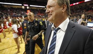 FILE - In this Feb. 24, 2018, file photo, Kansas coach Bill Self celebrates his team's victory over Texas Tech in an NCAA college basketball game, in Lubbock, Texas. Kansas coach Bill Self was named the coach of the year for the Big 12, Tuesday, March 6, 2018. (AP Photo/Brad Tollefson, File)
