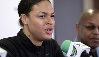 FILE - In this Feb. 26, 2018, file photo, Dallas Wings newly acquired center Liz Cambage, of Australia, responds to a question during a news conference at College Park Center Monday, Feb. 26, 2018, in Arlington, Texas. Basketball Australia said Wednesday, March 7, 2018, that Cambage will lead the national team at the Commonwealth Games which begin on April 4 on the Gold Coast south of Brisbane. (AP Photo/Tony Gutierrez, File)