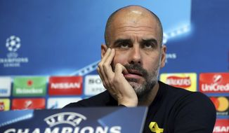 Manchester City soccer team manager Pep Guardiola reacts during the press conference in Manchester, England, Tuesday March 6, 2018. Manchester City play Basel in a Champions League clash upcoming Wednesday. (Martin Rickett/PA via AP)