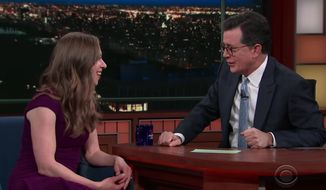 Former first daughter Chelsea Clinton told late-night comedian Stephen Colbert Monday night that Ivanka Trump shouldn't get a pass for answering tough questions about her father. (CBS)