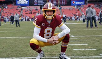 FILE - In this Dec. 24, 2017, file photo, Washington Redskins quarterback Kirk Cousins looks around the stadium before an NFL football game against the Denver Broncos in Landover, Md. After agreeing to a trade to acquire quarterback Alex Smith, the Redskins are moving on from the Kirk Cousins era. When the league year opens in mid-March, Cousins will be the top free agent available and find no shortage of suitors for his services. (AP Photo/Alex Brandon, File)