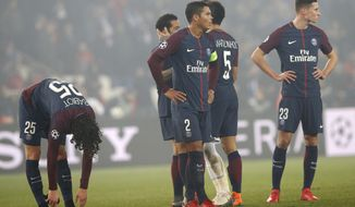 PSG players react to losing the Champions League round of sixteen second leg soccer match between Paris St. Germain and Real Madrid at the Parc des Princes stadium in Paris, France, Tuesday, March 6, 2018. (AP Photo/Christophe Ena)