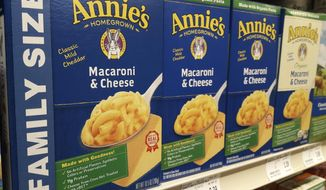 Boxes of Annie's Macaroni & Cheese are shown on the shelf at a supermarket in Edina, Minn., Sunday, March 4, 2018. Annie's is an organic and natural unit of food industry giant General Mills, which announced a deal Tuesday to create a 34,000-acre organic farm in South Dakota to supply it with organic wheat that will become pasta for the popular product. (AP Photo/Steve Karnowski)