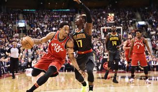 Toronto Raptors guard DeMar DeRozan (10) drives against Atlanta Hawks guard Dennis Schroeder (17) during the second half of an NBA basketball game Tuesday, March 6, 2018, in Toronto. (Frank Gunn/The Canadian Press via AP)