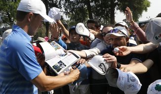 Jordan Spieth signs autographs for fans during after a practice round of the Mexico Championship, at the Chapultepec Golf Club in Mexico City, Wednesday, Feb. 28, 2018. (AP Photo/Marco Ugarte)
