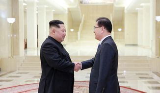 "In this Monday, March 5, 2018 photo, provided by the North Korean government on March 6, North Korean leader Kim Jong-un, left, shakes hands with South Korean National Security Director Chung Eui-yong in Pyongyang, North Korea. Independent journalists were not given access to cover the event depicted in this image distributed by the North Korean government. The content of this image is as provided and cannot be independently verified. Korean language watermark on image as provided by source reads: ""KCNA"" which is the abbreviation for Korean Central News Agency. (Korean Central News Agency/Korea News Service via AP)"