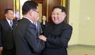 """In this Monday, March 5, 2018 photo, provided by the North Korean government on March 6, North Korean leader Kim Jong Un, front right, meets South Korean National Security Director Chung Eui-yong, front left, in Pyongyang, North Korea. Independent journalists were not given access to cover the event depicted in this image distributed by the North Korean government. The content of this image is as provided and cannot be independently verified. Korean language watermark on image as provided by source reads: """"KCNA"""" which is the abbreviation for Korean Central News Agency. (Korean Central News Agency/Korea News Service via AP)"""