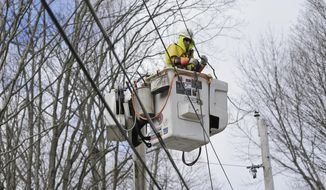Charlie Ruff with Jersey Central Power and Light works to repair power lines in Morristown, N.J., Monday, March 5, 2018. Tens of thousands of New Jersey residents remain without power and emergency officials are watching coastal areas for flooding following a powerful storm. (AP Photo/Seth Wenig)