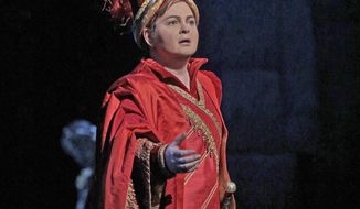"""This image released by the MetropolitanOpera shows American mezzo-soprano Elizabeth DeShong as the Assyrian warrior Arsace in Rossini's """"Semiramide,"""" which is enjoying a rare revival at the Metropolitan Opera and will be broadcast Live in HD to movie theaters worldwide this Saturday. (Ken Howard/MetropolitanOpera via AP)"""