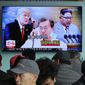 People watch a TV screen showing images of North Korean leader Kim Jong Un (right), South Korean President Moon Jae-in (center) and President Trump on Wednesday, Mr. Trump praised China for helping drive North Korea toward denuclearization talks. (ASSOCIATED PRESS)