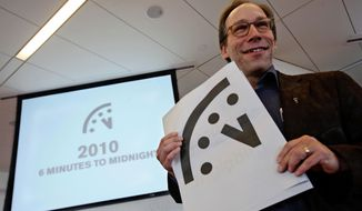 "Lawrence Krauss, co-chair of the Bulletin of Atomic Scientists Board of Sponsors poses with a graphic image of the ""Doomsday Clock"" a during a news conference,  Thursday, Jan. 14, 2010 in New York. The  Bulletin of Atomic Scientists adjusted the clock from 5 to 6 minutes before midnight. The clock tracks the threat of a global cataclysm. (AP Photo/Mary Altaffer)"