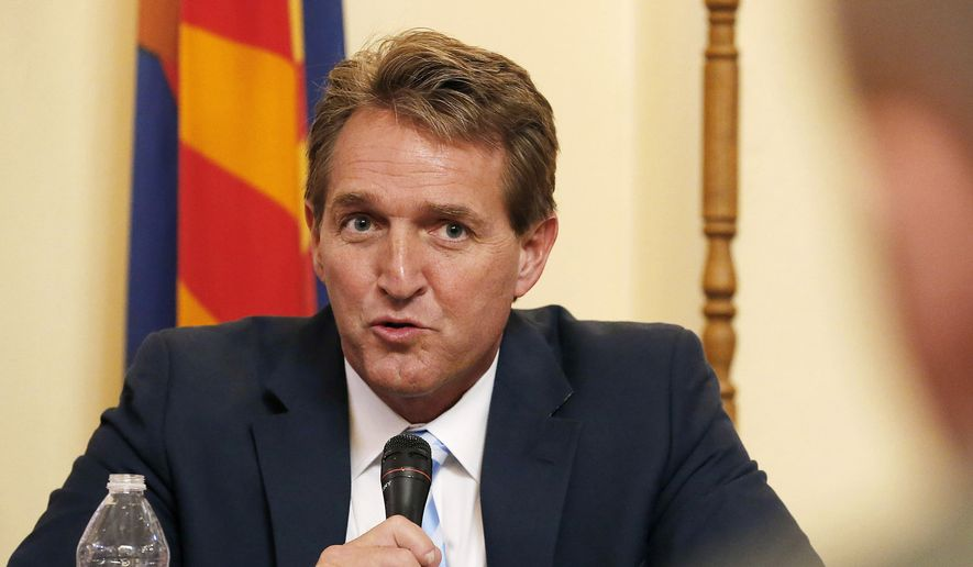 Sen. Jeff Flake, left, R-Ariz., speaks during a field hearing in Phoenix. (AP Photo/Ross D. Franklin, File)