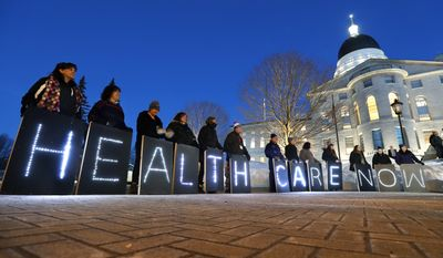 Mainers for Health Care rally outside the State House prior to Gov. Paul LePage's State of the State address, Tuesday, Feb. 13, 2018, in Augusta, Maine. The coalition that supported the successful Yes on 2 campaign to expand Medicaid in 2017 say LePage and his allies in the Legislature are trying to block Medicaid expansion, which is now state law. (AP Photo/Robert F. Bukaty)
