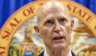 Florida Gov. Rick Scott lays out his school safety proposal during a press conference at the Florida Capitol in Tallahassee, Fla., Friday, Feb 23, 2018. Scott proposed banning the sale of firearms to anyone younger than 21 as part of a plan to prevent gun violence. (AP Photo/Mark Wallheiser) ** FILE **