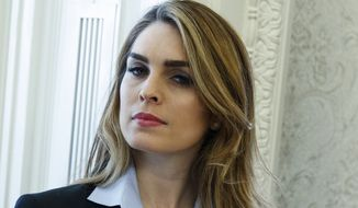 "In this Feb. 9, 2018 photo, White House Communications Director Hope Hicks is shown during a meeting in the Oval Office between President Donald Trump and Shane Bouvet, in Washington.  Hicks, one of President Donald Trump's most loyal aides, is resigning. In a statement, the president praises Hicks for her work over the last three years. He says he ""will miss having her by my side."" The news comes a day after Hicks was interviewed for nine hours by the panel investigating Russia interference in the 2016 election and contact between Trump's campaign and Russia.  (AP Photo/Evan Vucci)"