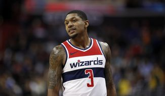 Washington Wizards guard Bradley Beal (3) walks on the court during the second half of an NBA basketball game against the Miami Heat, Tuesday, March 6, 2018, in Washington. The Wizards won 117-113 in overtime. (AP Photo/Alex Brandon)