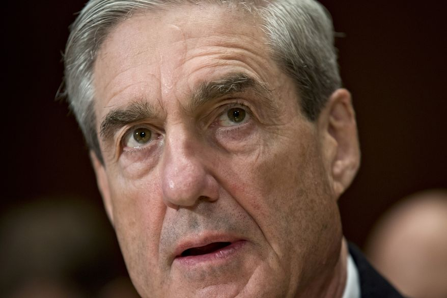 In this May 16, 2013 file photo, FBI Director Robert Mueller testifies on Capitol Hill in Washington before the Senate Appropriations, Commerce, Justice, Science subcommittee hearing on the fiscal 2014 budget request for the FBI. (AP Photo/J. Scott Applewhite, File)