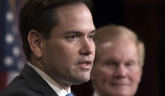 Sen. Marco Rubio, R-Fla., joined at right by Sen. Bill Nelson, D-Fla., holds a news conference to unveil his plan to address gun violence with legislation on restraining orders, at the Capitol in Washington, Wednesday, March 7, 2018. (AP Photo/J. Scott Applewhite) **FILE**