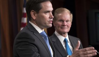 Sen. Marco Rubio, R-Fla., joined at right by Sen. Bill Nelson, D-Fla., holds a news conference to unveil his plan to address gun violence with legislation on restraining orders, at the Capitol in Washington, Wednesday, March 7, 2018. (AP Photo/J. Scott Applewhite)