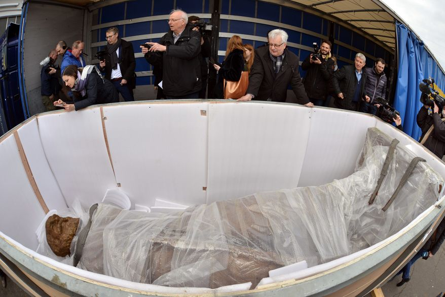 A statue of Karl Marx lies in a transport box as it arrived in Trier, Germany, Tuesday, March 6, 2018. A larger-than-life statue of Karl Marx has arrived in his hometown of Trier, in western Germany. The bronze sculpture, donated by China, is to be unveiled in May to mark the 200th anniversary of Marxs birthday.  (Harald Tittel/dpa via AP)
