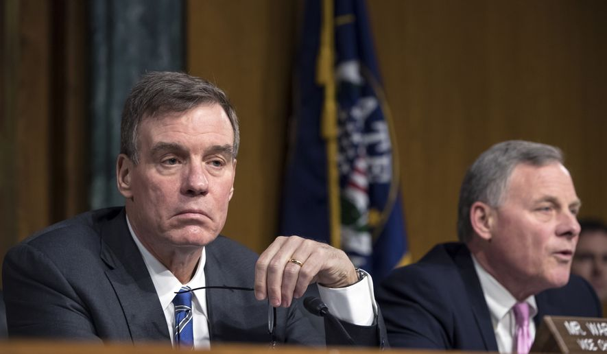 Vice Chairman of the Senate Intelligence Committee Mark Warner, D-Va., left, Chairman Richard Burr, R-N.C., are shown in this March 7, 2018 file photo. The intelligence committee will hear testimony on March 21 from Department of Homeland Secretary Kirstjen Nielsen and former DHS secretary Jeh Johnson about threats to U.S. election security from foreign hackers. (AP Photo/J. Scott Applewhite) **FILE**
