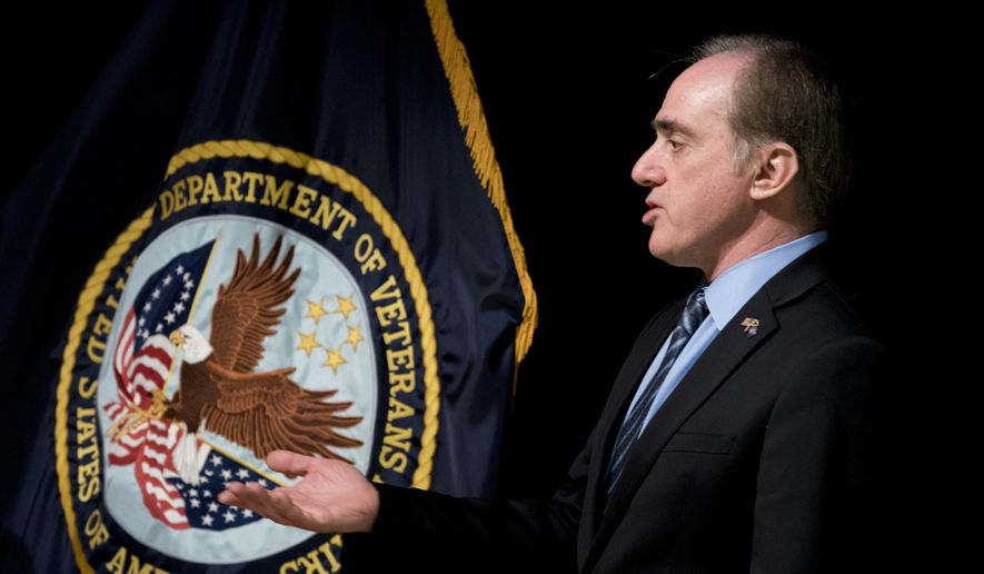 "Veterans Affairs Secretary David Shulkin speaks at a news conference at the Washington Veterans Affairs Medical Center in Washington, Wednesday, March 7, 2018, in response to a VA inspector general audit being released today. A new government investigation finds that Shulkin took no action to fix longstanding problems of dirty syringes and equipment shortages that put patients at risk at a major veterans hospital when he was undersecretary of health under the Obama administration, saying he was never told of problems reported to the VA offices under his watch. The harsh report by the VA inspector general cites ""failed leadership"" and a ""climate of complacency"" for patient safety issues dating back to 2013 and cautions of continuing problems without strong oversight. (AP Photo/Andrew Harnik)"