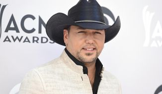 FILE - In this April 2, 2017 file photo, Jason Aldean arrives at the 52nd annual Academy of Country Music Awards in Las Vegas. Aldean, Luke Bryan, Miranda Lambert, and pop singer Bebe Rexha with Florida Georgia Line will be performing at the Academy of Country Music Awards in Las Vegas on April 15. (Photo by Jordan Strauss/Invision/AP, File)