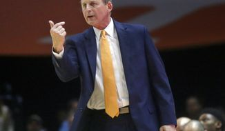 FILE - In this Feb. 13, 2018, file photo, Tennessee head coach Rick Barnes motions to one of his players during the second half of an NCAA college basketball game against South Carolina in Knoxville, Tenn. Barnes was selected as the AP SEC coach of year Tuesday, March 6, 2018. (AP Photo/Crystal LoGiudice, File)