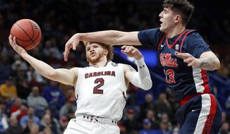 South Carolina's Hassani Gravett (2) shoots as Mississippi 's Dominik Olejniczak (13) defends during the first half in an NCAA college basketball game at the Southeastern Conference tournament Wednesday, March 7, 2018, in St. Louis. (AP Photo/Jeff Roberson)