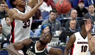 Georgia's Nicolas Claxton (33) dunks the ball over Vanderbilt's Djery Baptiste (12) during the first half in an NCAA college basketball game at the Southeastern Conference tournament Wednesday, March 7, 2018, in St. Louis. (AP Photo/Jeff Roberson)