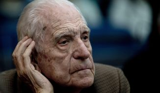 """FILE- In this March 5, 2013 file photo, former dictator Reynaldo Bignone attends the first day of the trial for his alleged involvement in the so called operation, """"Plan Condor,"""" in Buenos Aires, Argentina. Bignone, the last of the four de facto presidents of the Argentine dictatorship, died Wednesday, March 7, 2018. He was 90. (AP Photo/Natacha Pisarenko, File)"""