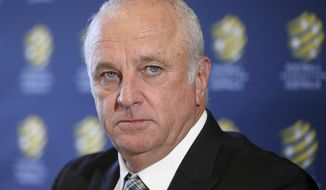 Graham Arnold attends a press conference where he will sign a four-year contract to coach the Australian national soccer team in Sydney, Thursday, March 8, 2018. Arnold, current coach of A-League champions Sydney FC, will replace Dutchman Bert van Marwijk after the World Cup in Russia. (AP Photo/Rick Rycroft)