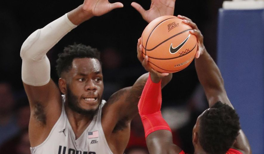 Georgetown center Jessie Govan (15) defends St. John's guard Bashir Ahmed (1) during the first half of an NCAA college basketball game in the first round of the Big East conference tournament, Wednesday, March 7, 2018, in New York. **FILE**