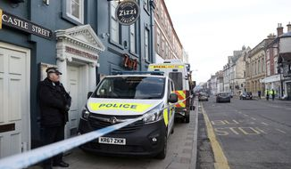 "A policeman stands outside the Zizzi restaurant in Salisbury, England Wednesday, March 7, 2018 near to where former Russian double agent Sergei Skripal was found critically ill. Britain's counterterrorism police took over an investigation Tuesday into the mysterious collapse of a former spy and his daughter, now fighting for their lives. The government pledged a ""robust"" response if suspicions of Russian state involvement are proven. Sergei Skripal and his daughter are in a critical condition after collapsing in the English city of Salisbury on Sunday. (Andrew Matthews/PA via AP)"