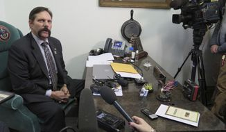 FILE - In this Feb. 13, 2018, file photo, Colorado Republican State Sen. Randy Baumgardner speaks to the media in Denver. Colorado Democrats on Wednesday, March 7, 2018, urged Republicans who control the state Senate to allow debate on a resolution to expel Baumgardner, who was investigated for alleged sexual misconduct. (AP Photo/Colleen Slevin, File)
