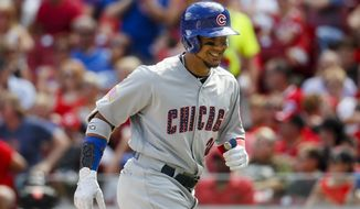 FILE - In this July 1, 2017, file photo, Chicago Cubs' Jon Jay smiles as he runs toward the dugout after hitting a solo home run off Cincinnati Reds starting pitcher Jackson Stephens in the third inning of a baseball game in Cincinnati. Jay agreed to a $3 million, one-year contract with the Kansas City Royals on Tuesday, March 6, 2018,  a deal that allows him to earn an additional $1.5 million in performance bonuses. (AP Photo/John Minchillo)