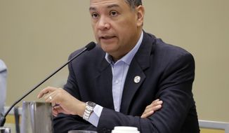 File - In this July 8, 2017 file photo, California Secretary of State Alex Padilla speaks during a voter registration meeting at the National Association of Secretaries of State conference in Indianapolis. California's top elections official said Wednesday, March 7, 2018, the state has aggressive safety procedures in place to protect its elections systems against Russian and other meddling but is ramping up even more ahead of the 2018 midterms. (AP Photo/Darron Cummings, File)