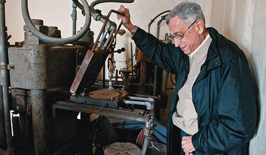 In this file photo, retired businessman Lionel Betancourt lifts a recording die on a Finebilt record press in San Benito, Texas. Betancourt donated equipment from San Benito's legendary Ideal Recording Co. for display in the Texas Conjunto Music Hall of Fame and Museum. (AP Photo/Valley Morning Star)