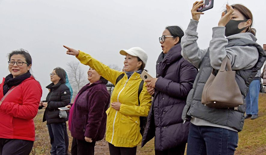 In a Monday, Feb. 26, 2018 photo,  group of Asian-Americans from Philadelphia gather at sunrise, at Middle Creek Wildlife Management Area in Stevens, Pa. When it comes to wildlife photography by Asian hobbyists, the Middle Creek spring migration and wintering bald eagles at the Conowingo Dam on the Susquehanna River are must-see destinations. (Ad Crable/LNP via AP)